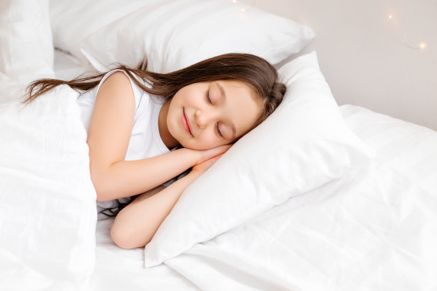 little-brunette-girl-sleeps-sweetly-bed-with-white-linen-space-text-healthy-baby-s-sleep_98296-3095